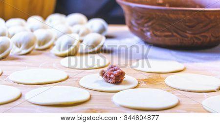 The Process Of Making Dumplings, Dumplings Or Meat Dumplings. Dumplings - Russian Dumplings On A Woo