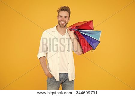 Consumerism Concept. Big Discount. Great Choices Great Purchases. Happy Man Holding Purchases In Pap