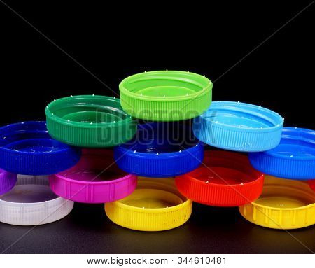 Multi-colored Bottle Caps Made Of Hdpe (high Density Polyethylene). Recyclable Materials.