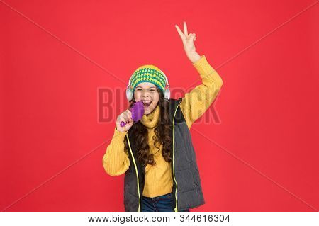 Come And Have Fun At Karaoke. Happy Child Sing Karaoke In Microphone Brush. Little Singer Enjoy Sing