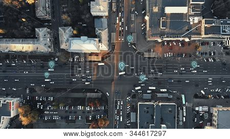 Aerial View Of City Intersection With Many Cars And Gps Navigation System Symbols. Autonomous Driver