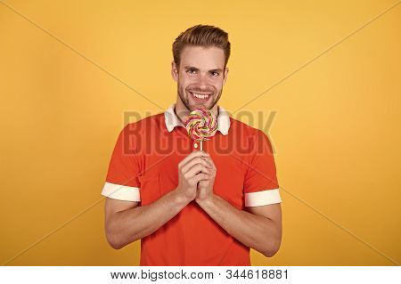Symbol Of Happiness. Man Eat Sweet Lollipop. Man Smiling Hold Lollipop. Cheat Meal Concept. Sugar Ha