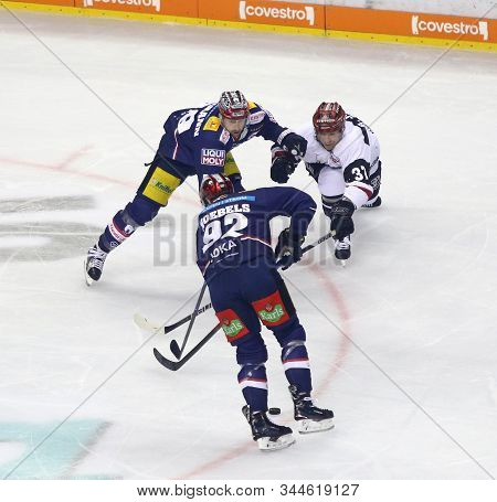 Berlin, Germany - September 22, 2017: Blair Jones Of Kolner Haie (r) Fights For A Puck With Jens Bax