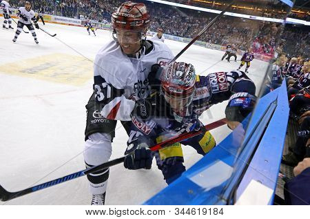 Berlin, Germany - September 22, 2017: Blair Jones Of Kolner Haie (l) Fights For A Puck With Daniel F