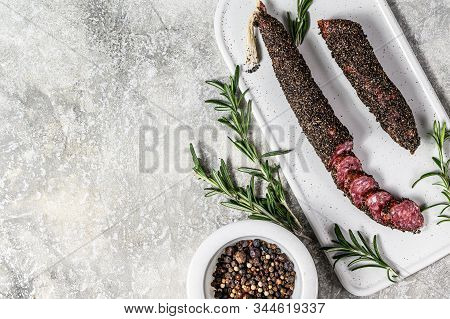 Wurst, Fuet, Sliced Sausage. Pork Sausage. Gray Background. Top View. Space For Text