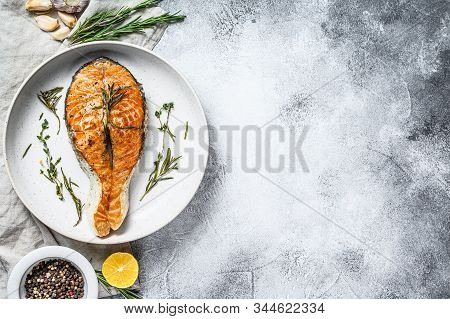 Grilled Salmon Steak. Atlantic Fish. Gray Background. Top View. Space For Text