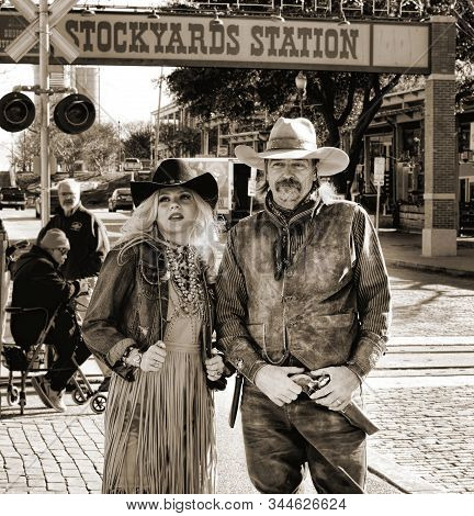 Fort Worth,texas, Jan.4,2020 - Fort Worth Stockyards  Cowgirl And Cowboy Standing Next To The Stocky