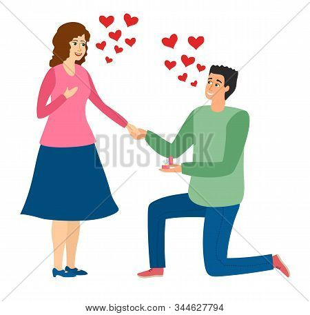 An Offer Of Marriage. Man Proposes A Woman To Marry Him And Gives An Engagement Ring. Couple In Love