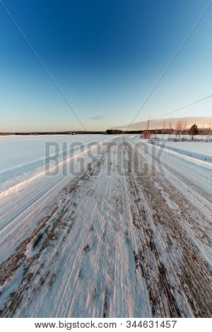 An Empty Road Is Covered With Ice In The Rural Finland. The Cold Weather Turns The Roads Slippery In