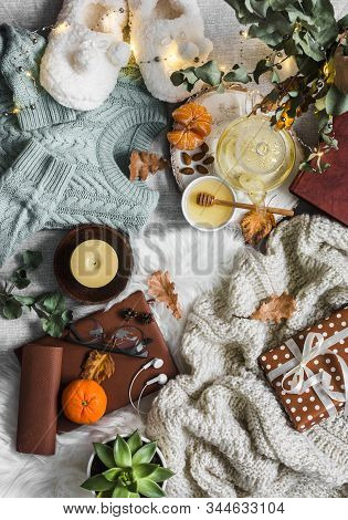 Home Coziness Still Life - Soft Slippers, Knitted Sweater, Plaid, Green Tea With Honey, Tangerines,