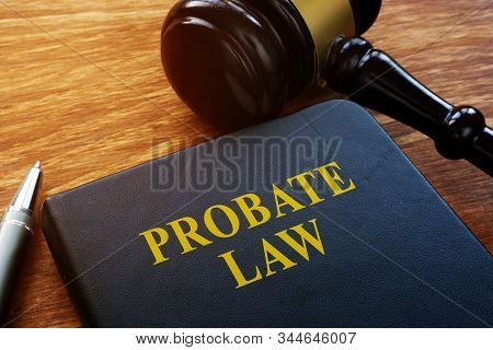 Probate Law Book And Wooden Gavel In The Court.
