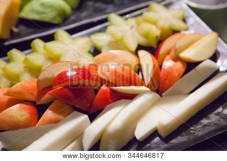 Fresh Assorted Tropical Asian Seasonal Fruits Serving (apple, Starfruit, Yam Or Jicama) In Black Tra