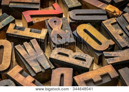 vintage letterpress wood type printing blocks (mirror image) against handmade bark paper