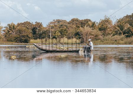 Maroantsetra, Madagascar October: 19.2016: Native Malagasy Man Fishing On River, Using Technique Pul