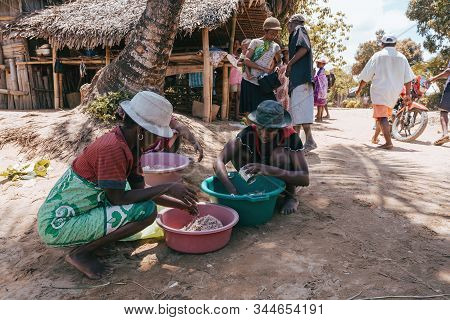 Maroantsetra, Madagascar October 20.2016: Native Woman Sort Catch On Village Common After Sea Fishin