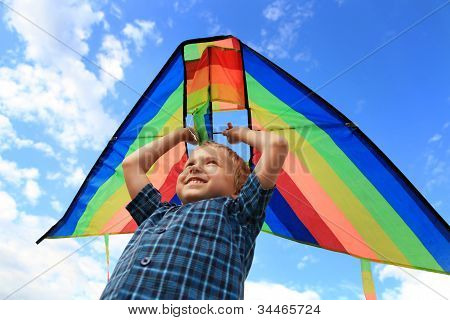 Boy With Bright Kite Over The Head