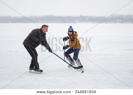 Dnipro, Ukraine - January 28, 2018: Teenager Girl Attacking Male Defender While Playing Hockey With