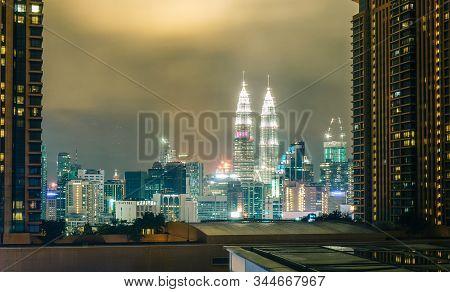 Kuala Lumpur, Malaysia - Jan 16, 2017. Kuala Lumpur Skyline With Petronas Twin Towers In Night. The