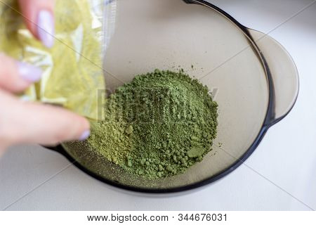 Mixing Henna With A Wooden Spoon In A Bowl For Hair Application Of Natural Color Like Indian Henna M