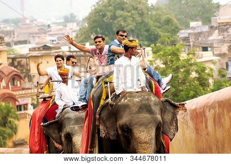 Tourists On An Elephant Ride