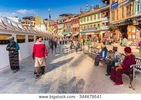 Kathmandu, Nepal - November 14, 2019: Nepalese Woman Walking Around The Boudhanath Stupa In Kathmand