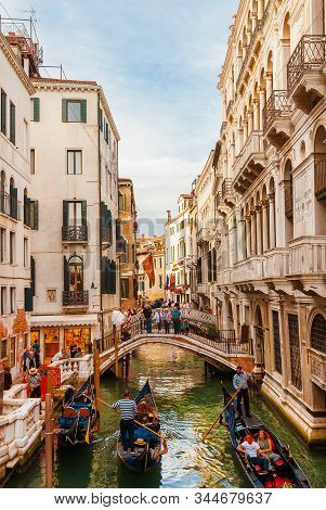 Venice, Italy - October 2: Tourism In Venice. People Watching Gondolas In Rio Di Palazzo Canal, Behi