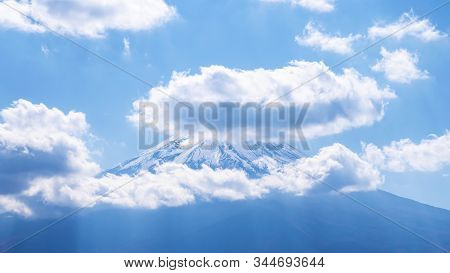 Close Up Of Fuji Mountain And White Cloud Over The Blue Sky In The Afternoon At Kawaguchiko Lake, Ya