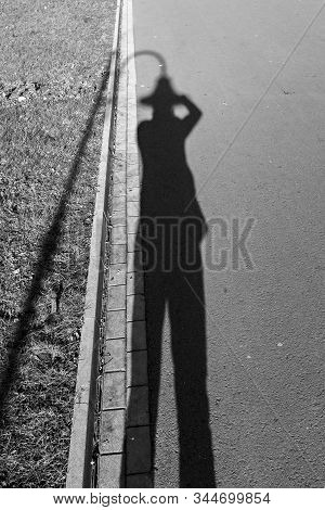 Selfies With A Shadow And A Street Lamp Like A Hat In Street Photography. Black And White Street Pho