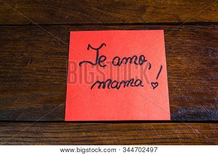 Writing I love you, mom in Spanish (te amo, mama) on memo post reminder. Text on sticky paper. Mother`s day concept. poster