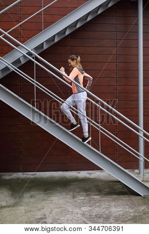 Sporty Young Woman On Fitness And Running Urban Workout Climbing Stairs For Hiit Cardio Training.