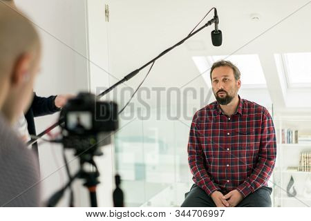 Middle aged man having interview indoors
