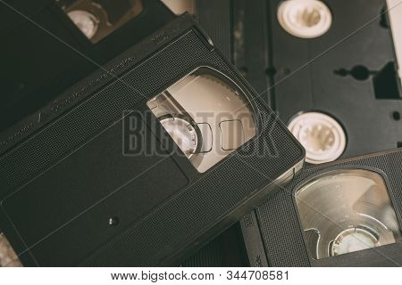 Stack Of Vhs Video Tapes As Background. Old Video Cassette  Tapes. Retro Technology.