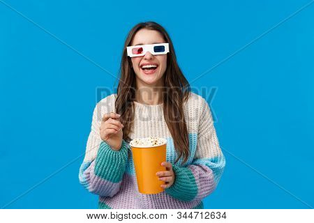 Girl Watching Comedy In Cinema. Carefree Happy Young Brunette Woman In Winter Sweater, Enjoying Funn