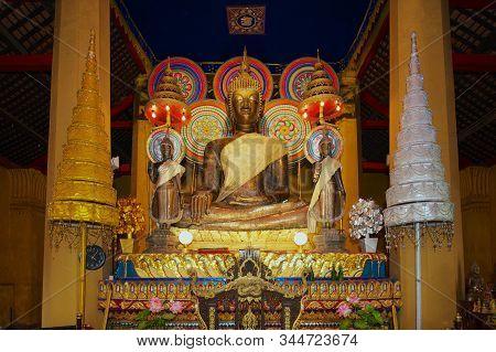 Vientiane, Laos - April 22, 2012: Altar With Golden Buddha Statues At The Wat Ong Teu Mahavihan (tem