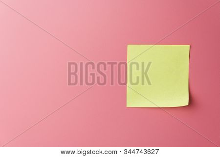 One Yellow Sticky Note Reminder On A Red Background