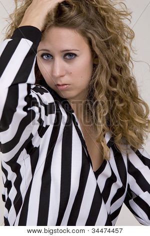 Young Woman In Referee Black And White Striped Shirt