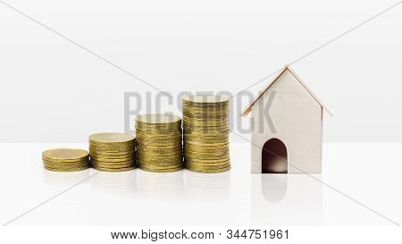 Property Investment Concept. Home Loan Mortgage. Financial Concept. Growing Stack Of Coins With Smal