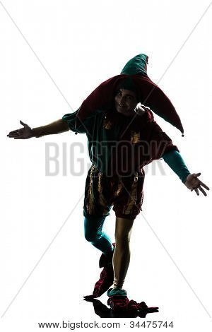 one caucasian man in jester costume saluting silhouette in studio isolated on white background