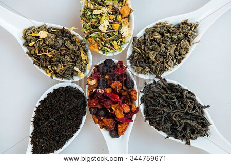 Assortment Of Dry Tea. Various Kinds Of Tea Isolated On White.different Kinds Of Tea Leaves. Tea Com