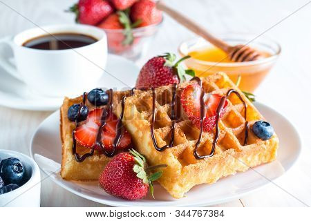 Fresh Homemade Food Of Berry Belgian Waffles With Honey, Chocolate, Strawberry, Blueberry, Maple Syr