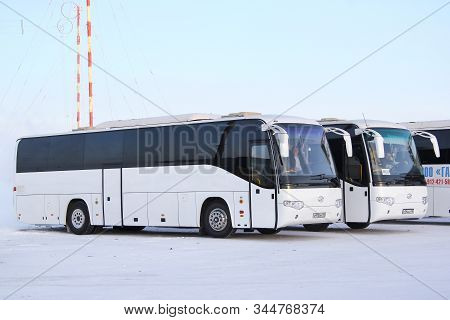 Novyy Urengoy, Russia - February 15, 2015: Intercity Coach Buses Higer Klq6119tq In The City Street.