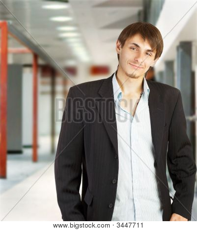 Young Businessman Walking In A Corridor