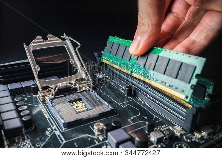 Installing A New Ram Ddr Memory For A Personal Computer Processor Socket In A Service. Upgrade Repai