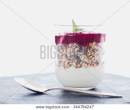 Homemade Granola Parfait With Berry Jam And Mint, Yogurt And Muesli Cereal As Healthy Breakfast Food