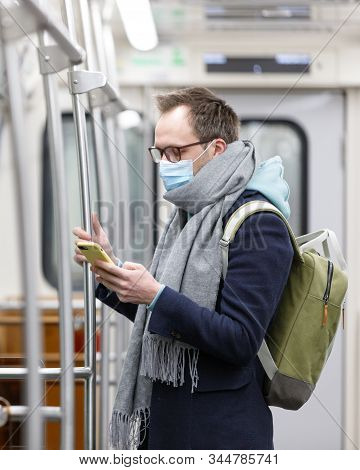 Common Cold.  Sick Man Breathing Through A Medical Mask Because Of The Danger Of Getting The Flu Vir
