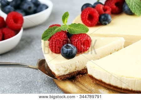 Homemade Cheesecake With Fresh Raspberries And Mint For Dessert - Healthy Organic Summer Dessert Pie