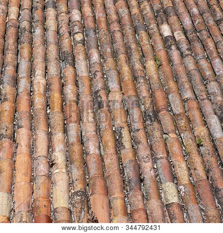 Roof Of Red Old Grunge Weathered Tiles.