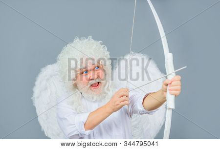 Cupid With Bow And Arrows. Love Concept. Valentine Angel. Handsome Male Angel Cupid. Bearded Man Wit
