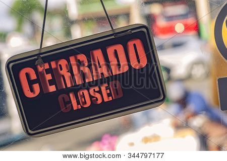 Closed, Cerrado Signal In A Door With Blurred Background