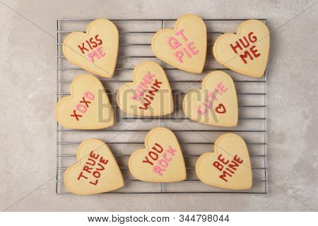 Valentines Day Concept: Flat lay Heart shaped sugar cookies on a cooling rack.